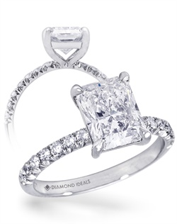 This custom ring features a 2.5 carat radiant-cut center stone (not ncluded in quoted price) surrounded by approx. 0.35 carats of mêlée diamonds (1.8mm) and a tapered basket head. All rings can be order in any metal.