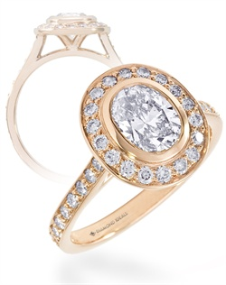 This customized version of our Heritage engagement ring features a 1.25ct oval center stone (not ncluded in quoted price) and approx. 0.65ctTW of 1.5mm m&#234;l&#233;e diamonds on the halo and shank. Note how the the ring is designed to accomodate a flush fitting wedding ring. All rings can be order in any metal.