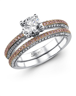 18K white and rose gold wedding set comprised of 0.33ctw round white Diamonds and 0.17ctw round pink Diamonds.