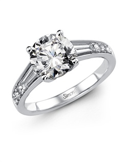 18K white gold ring comprised of 0.16ctw round white Diamonds and 0.51ctw baguette cut Diamonds.