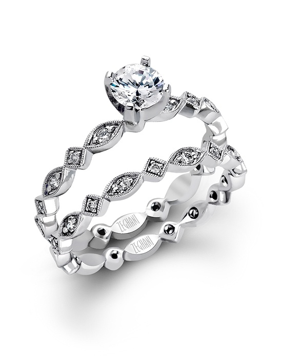 14K white gold wedding set comprised of 0.29ctw round white Diamonds.