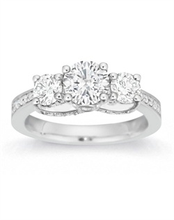 Fit for a queen, this elegant three-stone setting is regal yet approachable.