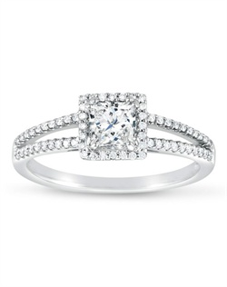 This ethereal ring showcases a princess cut center with a dual band of dazzling diamonds.