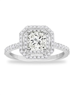 She will be in seventh heaven when presented with this rapturous ring highlighting a radiant center surrounded by a double halo of diamonds.