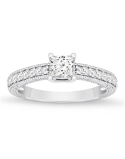 Enticing engraving adds just the right amount of detail to this lovely ring with a princess cut center.