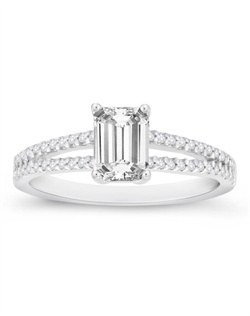 A bridal beauty, this emerald-cut engagement ring is sure to astound her.
