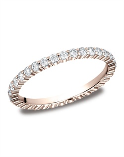 This elegant 2mm comfort-fit shared prong eternity diamond band features round ideal cut diamonds. Total approximate carat weight is .66ct.