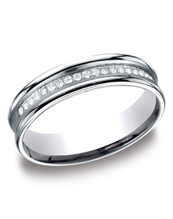 This stylish 5.5mm comfort-fit concave pave set channel diamond band features a satin-finished center with beautiful round ideal-cut diamonds and high polished edges. Total diamond carat weight is approximately .28ct.