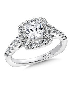 A sparkling cushion shape diamond halo lights up the princess cut center in this classic diamond fishtail-set ring.  This engagement ring is part of the Eternal Collection. Cushion shape halo mounting .50 ct. tw., 1 ct. Princess cut center. Price excludes center stone