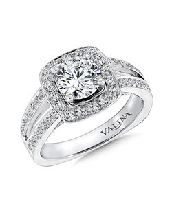 Two rows of diamonds rise and flare to meet the center in the halo surround. The pave-set and surprise diamond in the profile is a beautiful finish. Cushion shape halo mounting .56 ct. tw., 1 ct. round center.  Price excludes center stone