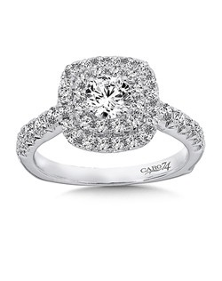 14K White Gold CARO 74 RING with platinum head. A round diamond center stone is framed by a cushion shaped double halo and diamond side stones on the ring's shoulders. Also available in white gold, yellow gold, 18K and Platinum. Price excludes center stone