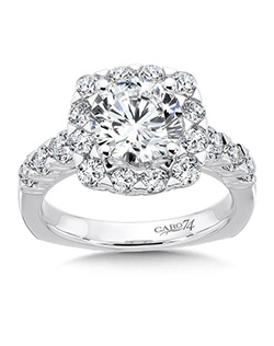 14K White Gold CARO 74 RING with platinum head.  Lavish diamond halo frames the center stone on this luxurious engagement ring. A secret diamond is nestled on the ring's under gallery and a string on diamonds flank the sides .  Also available in white gold, yellow gold, 18K and Platinum. Price excludes center stone