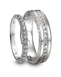 Coast Diamond platinum and diamond fishtail women's wedding band and platinum engraved men's wedding band.<BR><BR>Facebook: https://www.facebook.com/jewelryplatinum?fref=ts