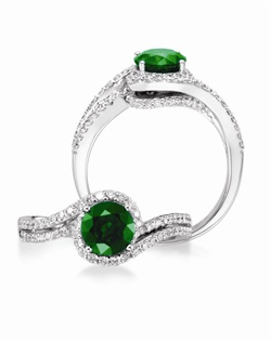14K White Gold Emerald and Diamond Engagement Ring. A 6.5mm round Emerald is surrounded by 0.44cttw of round brillant diamonds