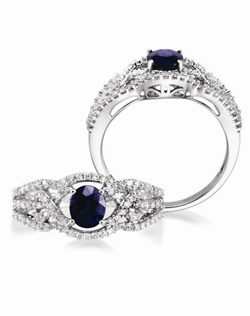 14K White Gold Sapphire and Diamond Engagement Ring. A 0.90ct oval Sapphire is surrounded by 0.52cttw of round brillant diamonds.