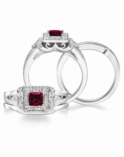 14K White Gold Ruby and Diamond Wedding Set. A 0.54ct Princess cut Ruby is surround by 0.22cttw of round brillant diamonds. A coordinating band is available.