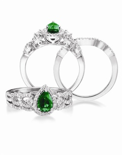 14K White Gold Emerald and Diamond Engagement Ring. A 7X5mm Pear Shaped Emerald is surrounded by .25 cttw of round brillant diamonds. Available with coordinating wedding band with .08cttw round brillant diamonds
