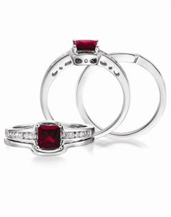 14K White Gold Ruby and Diamond Wedding Set. A 5mm Princess cut Ruby is accented by 0.18 cttw round brillant diamonds. Available with a coordinating 14K White Gold band.