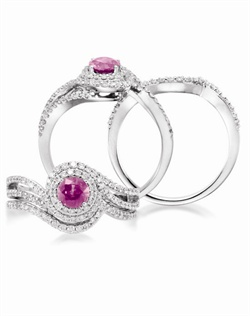 14K White Gold Pink Sapphire and Diamond Engagement Ring. A 0.60ct round Pink Sapphire is surrounded by 0.44cttw of round brillant diamonds. Available with a coordinating wedding band with 0.15cttw of round brillant diamonds.