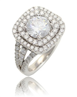 Two halos with a strike of our signature triple diamond shank. This Sage ring is shown in white gold and diamonds. Available in any size center and metal. ( Center not included ) 94 DIA 1.25 CT