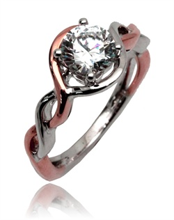 With a modern twist, this high polished ring will have every girl smiling. This Sage ring is shown with a combination of high polish pink and white gold. Avaialbe in any size center and metal. ( Center not included )
