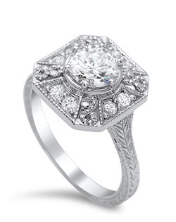 antique style filigree ring trimmed in milgrain featuring 0.24 carats of diamonds and engraved tapered shank