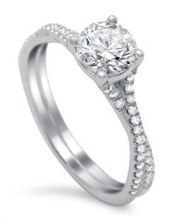 "a ""twist"" on the traditional solitaire. 0.25 carats of pave diamonds down shank"