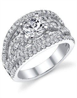This stunning semi-mount is shown with a 1ct center diamond. Available in 18K white, yellow or rose gold and platinum. Prong set for durability with diamonds calibrated to 1/100th of a millimeter. Settings can be custom made to fit any size or shape center stone. Total weight of semi-mount 1.30 Ct. Matching band available - Style number DR-339A