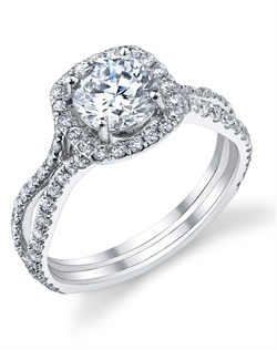This stunning semi-mount is shown with a 1ct center diamond. Available in 18K white, yellow or rose gold and platinum. Prong set for durability with diamonds calibrated to 1/100th of a millimeter. Settings can be custom made to fit any size or shape center stone. Total weight of semi-mount 0.68 Ct. Matching band available - Style number DR-250A