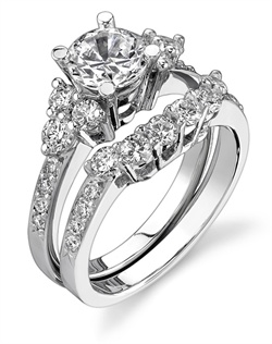 This stunning bridal set is shown with a 1ct center diamond. Available in 18K white, yellow or rose gold and platinum. Prong set for durability with diamonds calibrated to 1/100th of a millimeter. Settings can be custom made to fit any size or shape center stone. Total weight of semi-mount 0.51 Ct., total weight of matching band 0.51 Ct. Each piece sold separately.