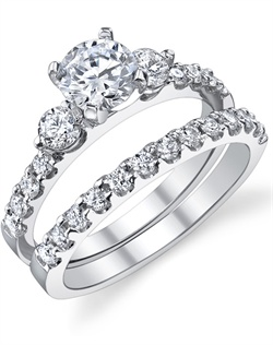 This stunning bridal set is shown with a 1ct center diamond. Available in 18K white, yellow or rose gold and platinum. Prong set for durability with diamonds calibrated to 1/100th of a millimeter. Settings can be custom made to fit any size or shape center stone. Total weight of semi-mount 0.46 Ct., total weight of matching band 0.32 Ct. Each piece sold separately.