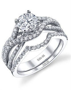 This stunning bridal set is shown with a 1ct center diamond. Available in 18K white, yellow or rose gold and platinum. Prong set for durability with diamonds calibrated to 1/100th of a millimeter. Settings can be custom made to fit any size or shape center stone. Total weight of semi-mount 0.42 Ct., total weight of matching band 0.23 Ct. Each piece sold separately.
