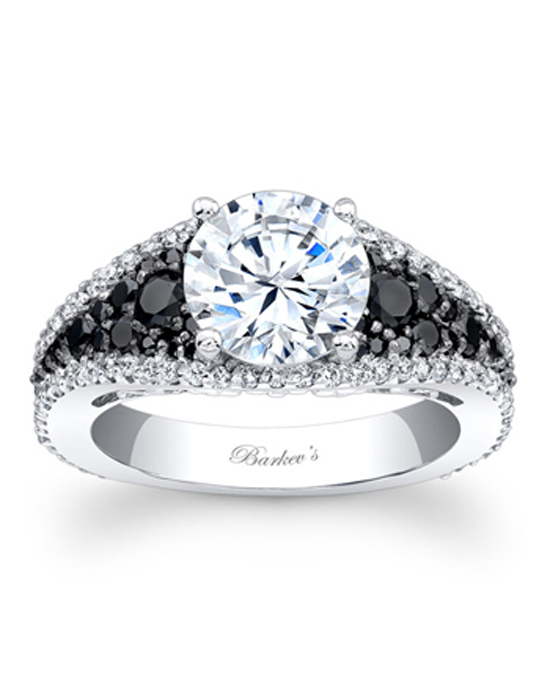 This unique, black and white diamond engagement ring features a prong set round diamond center, the white gold shank sports shared prong set white diamonds framing the black diamonds filling the center of the tapering shoulders for a stunning contemporary flair. Also available in yellow gold, rose gold, 18k and Platinum.
