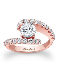 This unique diamond engagement ring features a rose gold split shank. A prong set round diamond center is cradled in the open center with shared prong set diamonds gracing the shoulders for a dramatic effect that is nothing short of spectacular. Also available in white gold, yellow gold, 18k and Platinum.