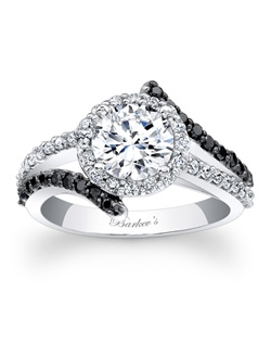This unique, black and white diamond halo engagement ring features a prong set round diamond center, with a diamond halo encircling it. The split shank that rises to the center halo is adorned with black and white shared prong diamonds for added drama. Also available in rose gold, yellow gold, 18k and Platinum.
