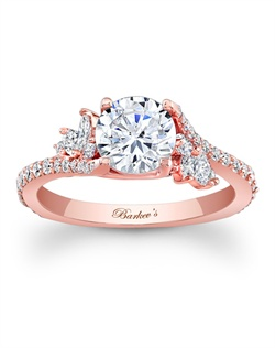 Simply elegant describes this rose gold diamond engagement ring. Featuring a prong set round diamond center graced on each side with a flare of marquise diamonds and round diamonds cascading down the dainty shank for a touch of sheer elegance. Also available in white gold, yellow gold, 18k and Platinum.