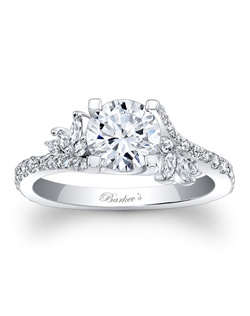 Simply elegant describes this white gold diamond engagement ring. Featuring a prong set round diamond center graced on each side with a flare of marquise diamonds and round diamonds cascading down the dainty shank for a touch of sheer elegance. Also available in rose gold, yellow gold, 18k and Platinum.
