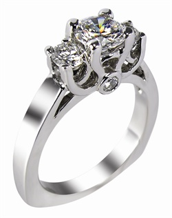 This 18kt White Semi-Mount is shown with a  1.2ct diamond center, and .50ctw GHSI 1 diamonds. Available in 14/18k white, yellow, or rose gold, platinum, or palladium. Ring can be customized to fit any size/shape diamond or gemstone center. Center stone sold separately.