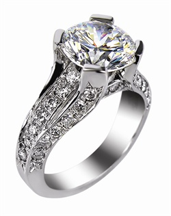 This 14kt White Semi-Mount is shown with a 4ct diamond center, and  1.25ctw diamonds. Available in 14/18k white, yellow, or rose gold, platinum, or palladium. Ring can be customized to fit any size/shape diamond or gemstone center. Center stone sold separately.