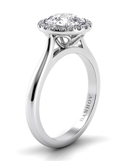Platinum mounting with .11tcw of diamonds in halo, center stone not included