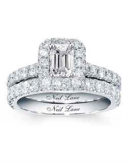A captivating emerald-cut diamond is the star of this engagement ring from the Neil Lane Bridal® collection. Round diamonds frame the center and line the band. The diamond engagement ring has a total diamond weight of 1 3/8 carats. The classic matching diamond wedding band displays a row of diamonds totaling 1/2 carat in weight. Both rings in the set are crafted in 14K white gold and feature Neil Lane's signature on the inside of the band. The bridal set has a total diamond weight of 1 7/8 carats.