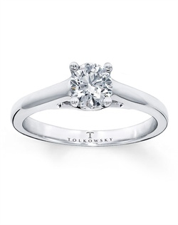 It has been nearly a century since Marcel Tolkowsky revolutionized diamond cutting with the original Ideal Cut Diamond. This stunning solitaire ring features an independently certified, 1/2 carat Tolkowsky® round brilliant diamond as its breathtaking centerpiece. Platinum prongs secure the diamond, and a 14K white gold band completes the elegance. This Tolkowsky® round brilliant diamond is certified Ideal Cut with the Hearts & Arrows Pattern and comes with a certificate of authenticity and a unique presentation box. Diamond Total Carat Weight may range from .45 - .57 carats.