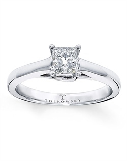 It has been nearly a century since Marcel Tolkowsky revolutionized diamond cutting with the original Ideal Cut Diamond. This timeless ring features an independently certified 1/2 carat Tolkowsky® princess-cut diamond for stunning style. This fine jewelry solitaire ring is secured by platinum prongs and complemented by a band of 14K white gold. All Tolkowsky® princess-cut diamonds are certified Ideal Cut and each ring comes with a certificate of authenticity. The ring comes with a unique presentation box. Diamond Total Carat Weight may range from .45 - .57 carats.