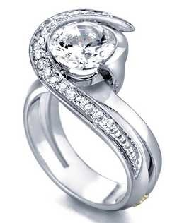 The Vision engagement ring contains 18 diamonds, totaling 0.245ctw. Shown with a 1ct center diamond. Center stone sold separately, not included in price. Available in yellow, white, or rose gold, and platinum. Rings can be custom made to fit any size or shape diamond or color center stone. Price excludes center stone