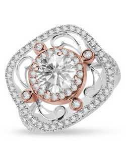 This large halo ring with wire detailing will remind her that every moment is unforgettable. This ring is crafted in 14k white and pink gold and has 0.78ct round brilliant accent stones. Available to accommodate various size center stones.