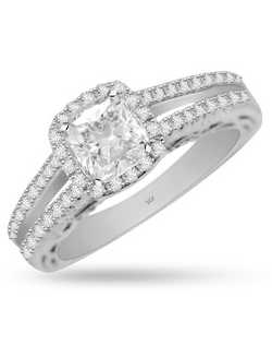 Quality to last a lifetime. Crafted in 14k white gold this engagement ring is featuring a 5.2mm cushion shaped halo center with 0.51cts round brilliants surrounding it. This ring has intricate detailing on the side view and you will fall in love with the details. Matching band is avaialble as special order