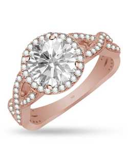 Take her breath away with stunning diamonds and unique design. This sparkling engagement ring features a round cut halo, braided design with 0.42cts round brilliant cut accents, and will hold a 6.3mm round center stone. Set in 14k pink gold. The center stone and wedding band are sold seperately.