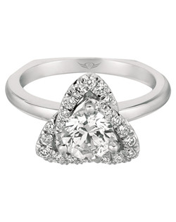 FlyerFit® Micropave engagement ring in 18K White Gold. This style is overall an antique look conveyed by a highly precise setting of diamonds. This style can be worn as a right hand ring or as an engagement ring. Shown here with Round Center Stone. All FlyerFit® rings feature Hearts and Arrows Diamonds.