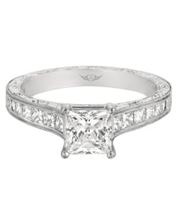 FlyerFit® Contemporary Engagement ring in 14K White Gold with milgraine and hand engraved shank. This stunning design features a Princess Cut Center Stone set off by a lustrous Princess Cut Channel Set Shank highlited with elegant hand engraving and delicate milgraine. All FlyerFit® rings feature Hearts and Arrows diamonds.