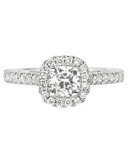 Combining old world european elegance with modern touches, this FlyerFit®by MartinFlyer  Vintage Engagment Ring in White Gold inspires true romance with flourishes of hand engraving, scroll work, micropave on the shank and a cushion halo. Shown here with a Round Center Stone.  All FlyerFit® rings feature Hearts and Arrows diamonds.